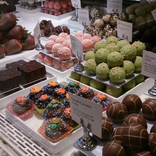 Photo taken at Godiva Chocolatier by Osama M. on 8/19/2013