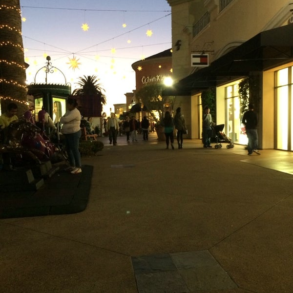 Photo taken at Carlsbad Premium Outlets by Mario F. on 12/23/2013