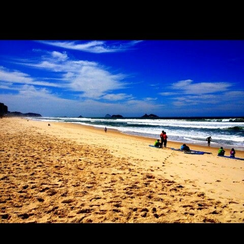 Photo taken at Praia da Barra da Tijuca by Jade M. on 7/21/2013