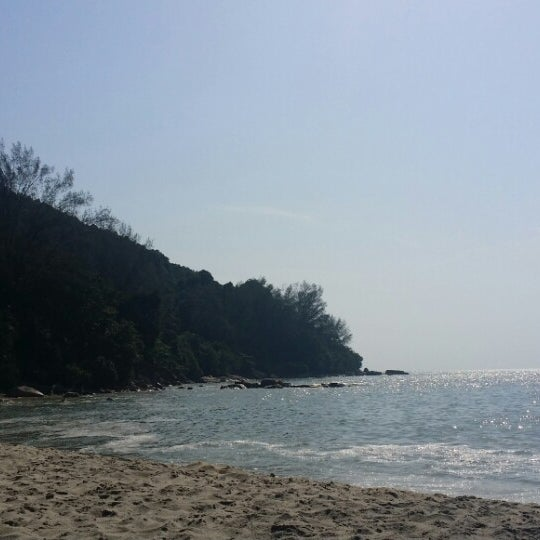 Photo taken at Teluk Bahang Beach by Jeslyn H. on 6/19/2014
