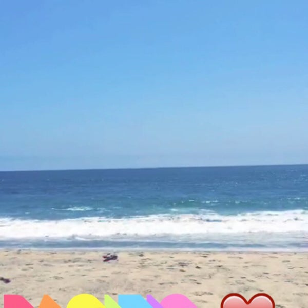 Photo taken at Pacific Palisades Beach by Yazeed A. on 7/29/2015