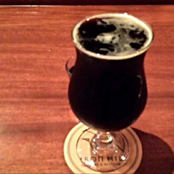 Photo taken at Iron Hill Brewery & Restaurant by Gerry D. on 2/23/2014