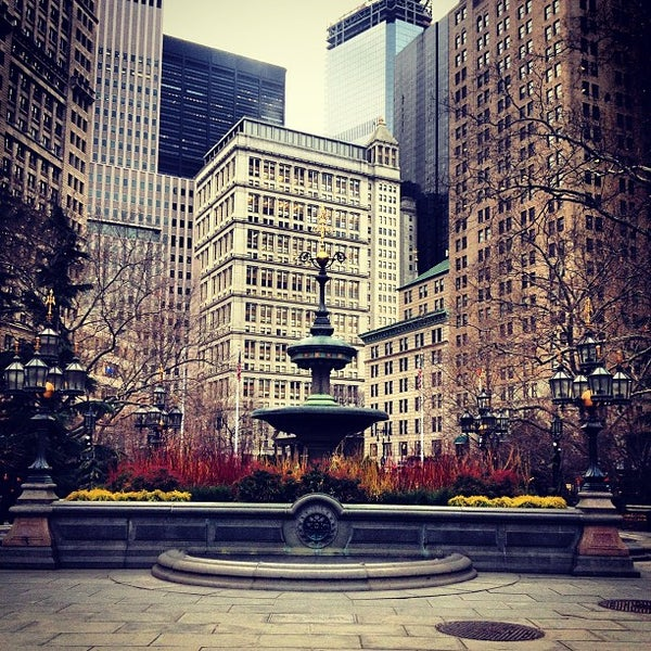 Photo taken at City Hall Park by Lina J. on 12/25/2012
