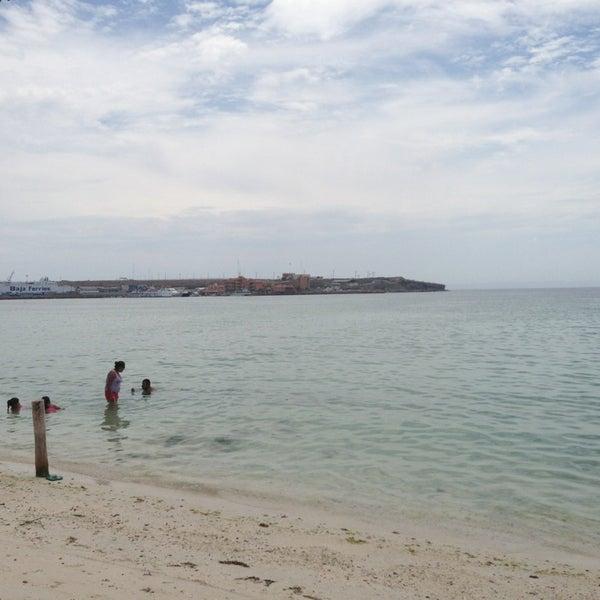 Photo taken at Playa Pichilingue by Héctor L. on 8/4/2013