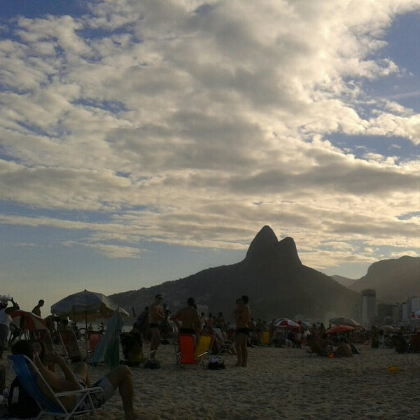 Photo taken at Praia de Ipanema by Elza C. on 7/6/2014