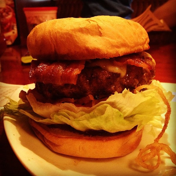 Photo taken at Elephant Bar Restaurant by Greg Z. on 7/13/2013