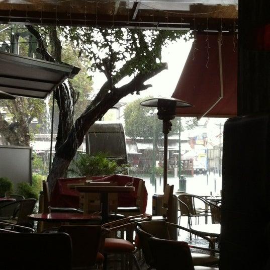 Photo taken at Azuca Latin Bistro by Carolina L. on 3/5/2012