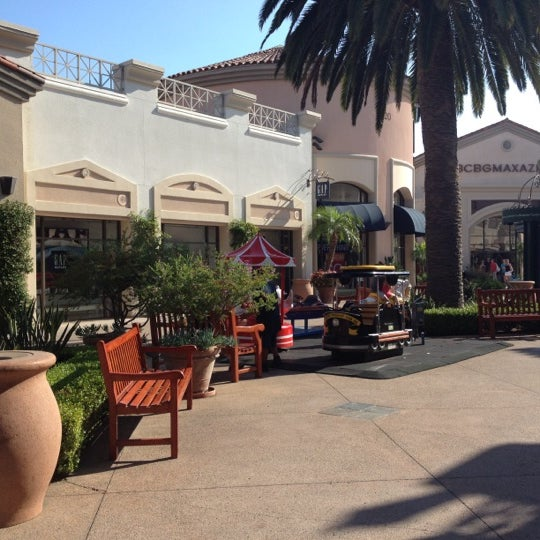 Photo taken at Carlsbad Premium Outlets by Marilena C. on 8/17/2012