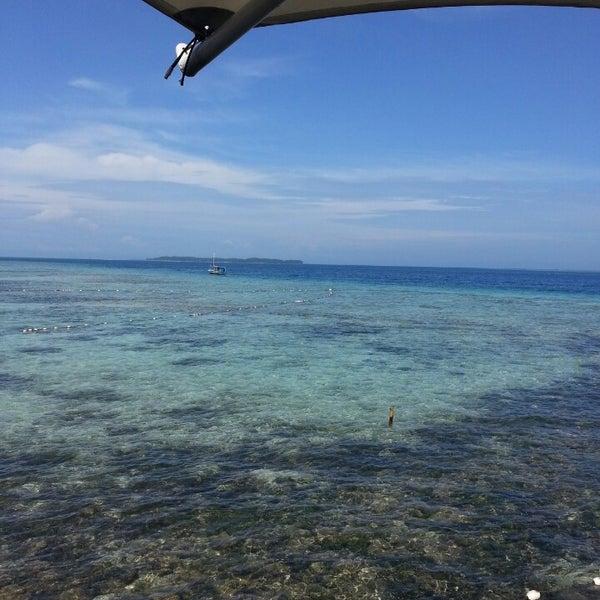 Photo taken at Pulau Pramuka by Selly E. on 4/13/2014