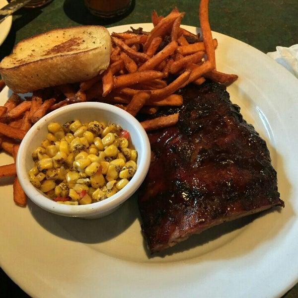 Photo taken at Smokey Bones Bar & Fire Grill by Eric C. on 5/9/2015