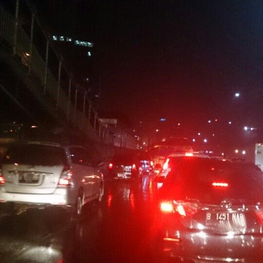 Photo taken at Perempatan Kuningan (Traffic Light) by Adhe M. on 2/9/2015