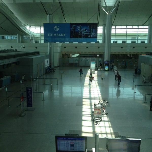 Photo taken at Tan Son Nhat International Airport (SGN) Sân Bay Quốc Tế Tân Sơn Nhất by Carla C. on 5/8/2013