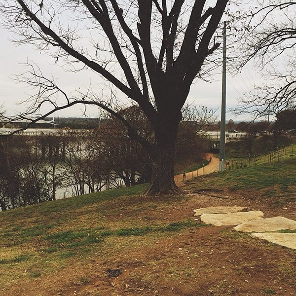 Photo taken at Lady Bird Lake Trail by Brittany D. on 3/9/2014