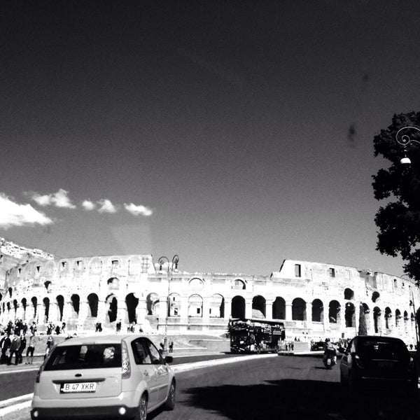 Photo taken at Piazza del Colosseo by Arabear on 3/9/2014