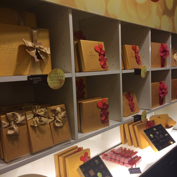 Photo taken at Godiva Chocolatier by Ksenia K. on 12/28/2014