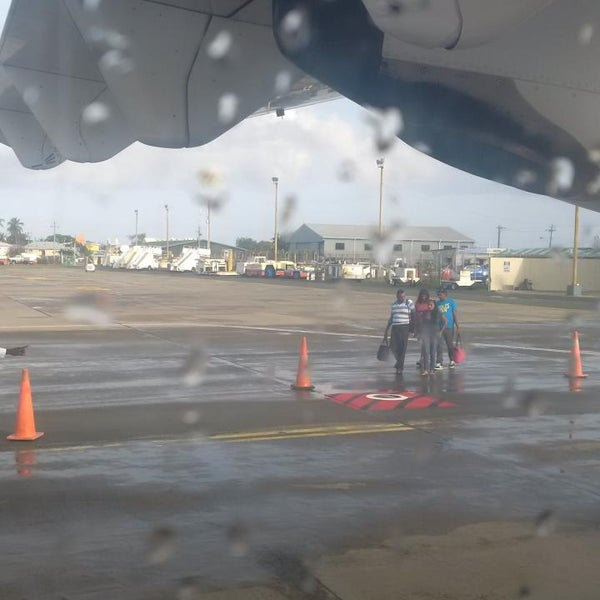 Photo taken at A.N.R. Robinson International Airport (TAB) by Shaka H. on 6/20/2014