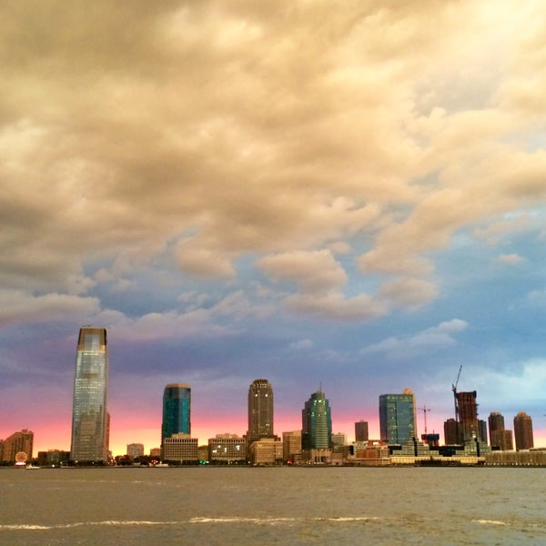 Photo taken at Battery Park City Esplanade by Christine O. on 7/22/2015