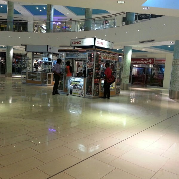 Photo taken at Trincity Mall by Dwight N. on 1/31/2014
