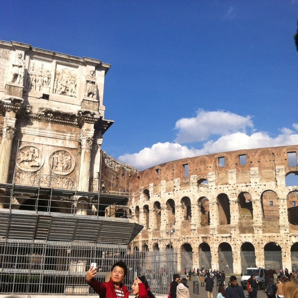 Photo taken at Piazza del Colosseo by Juan Ramon S. on 2/25/2014