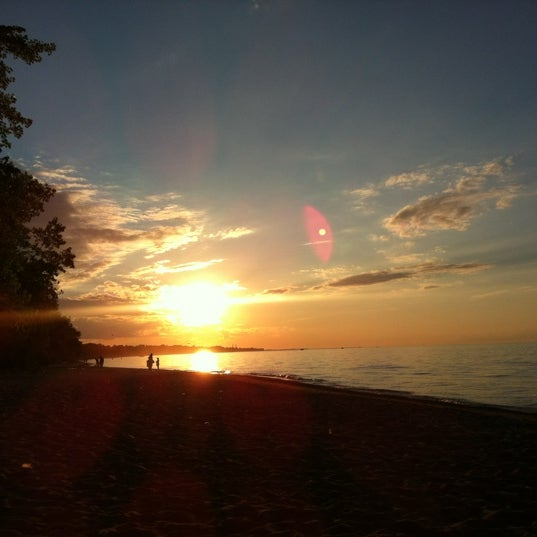 Photo taken at Durand Eastman Beach by Jennifer C. on 7/2/2012
