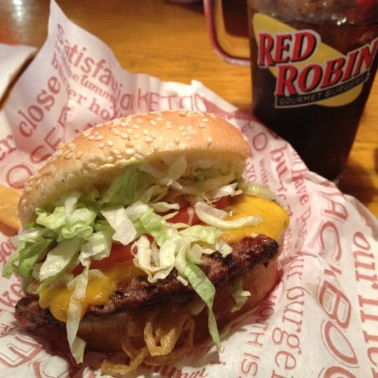 Photo taken at Red Robin Gourmet Burgers by Jonathan G. on 3/18/2012