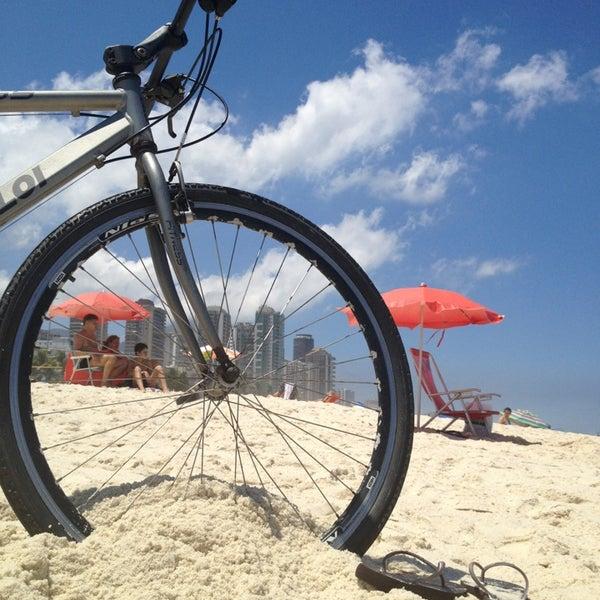 Photo taken at Praia da Barra da Tijuca by Beatriz A. on 3/3/2013