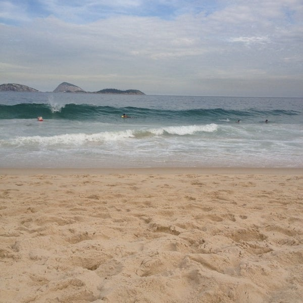 Photo taken at Praia de Ipanema by Marcela R. on 7/7/2014