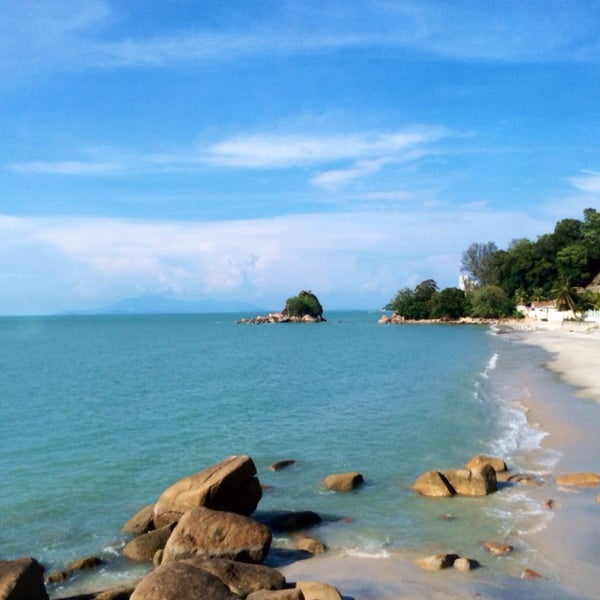 Photo taken at Teluk Bahang Beach by Angelica M. on 4/18/2014