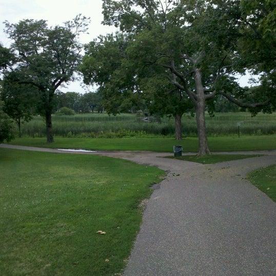 Photo taken at Loring Park by Morgan J. on 7/22/2012