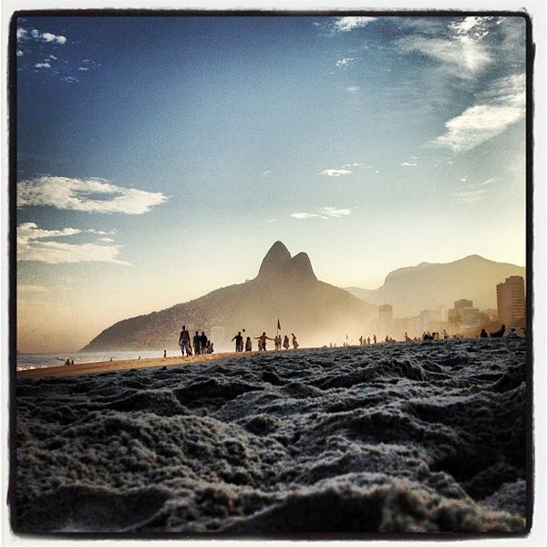 Photo taken at Praia de Ipanema by Steven K. on 6/16/2013