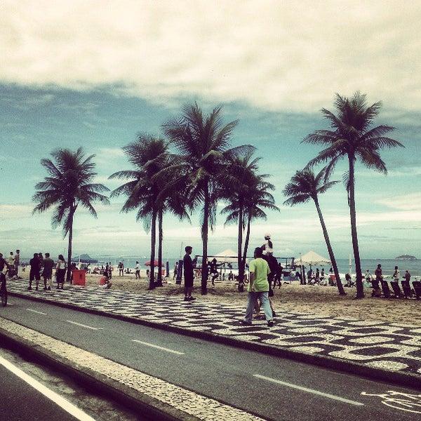 Photo taken at Praia de Ipanema by Amandinha A. on 5/20/2013