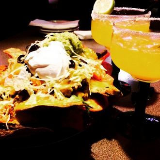 Photo taken at Sunset Cantina by Sunset Cantina on 2/25/2015