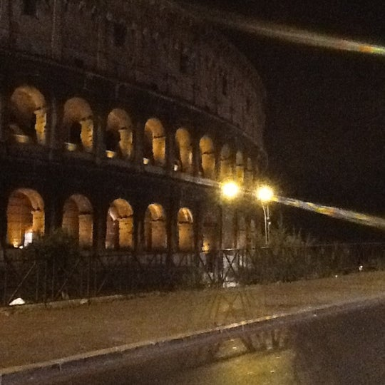 Photo taken at Piazza del Colosseo by Denis E. on 7/17/2012