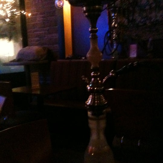 Photo taken at Nara Cafe Hookah Bar by Aimee C. on 12/24/2011