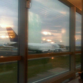 Photo taken at Gate A25 by Luis M. on 3/30/2012