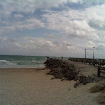 Photo taken at South Pointe Pier by Greg B. on 1/31/2012