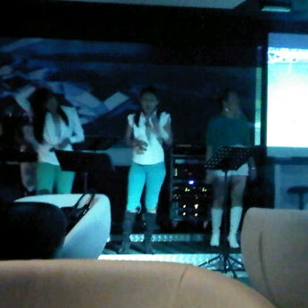 Photo taken at Crossroads Lounge by Rie T. on 1/27/2012