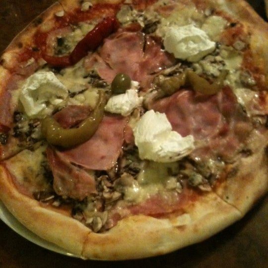 Photo taken at Pizzeria Luna by Helena on 12/29/2011
