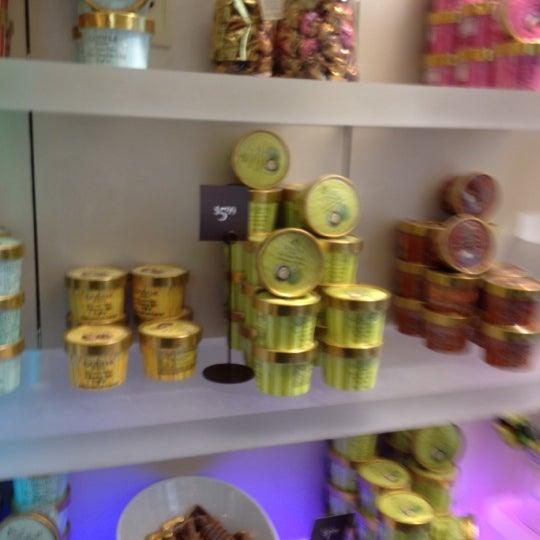 Photo taken at Godiva Chocolatier by BORAM K on 8/16/2012