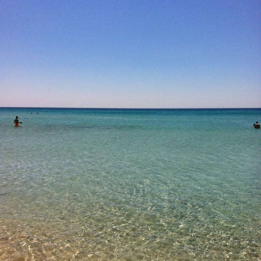 Photo taken at Ramo Beach by Burak Ö. on 7/16/2012
