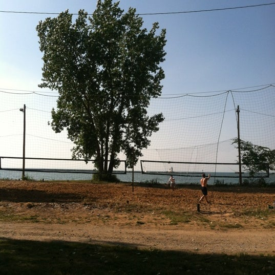 Photo taken at Whiskey Island Volleyball Courts by Chris G. on 6/19/2012