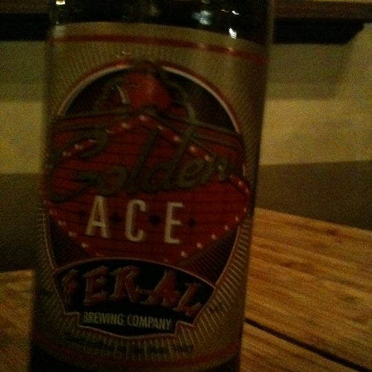 Photo taken at Feral Brewing Company by Karrie L. on 6/4/2011