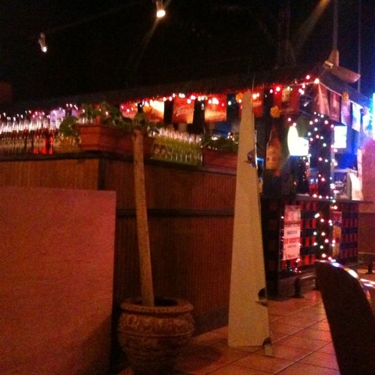 Photo taken at Mexi-Go Bar & Grill by brooks g. on 12/30/2010
