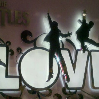 Photo taken at The Beatles LOVE (Cirque Du Soleil) by Jenn B. on 8/28/2011