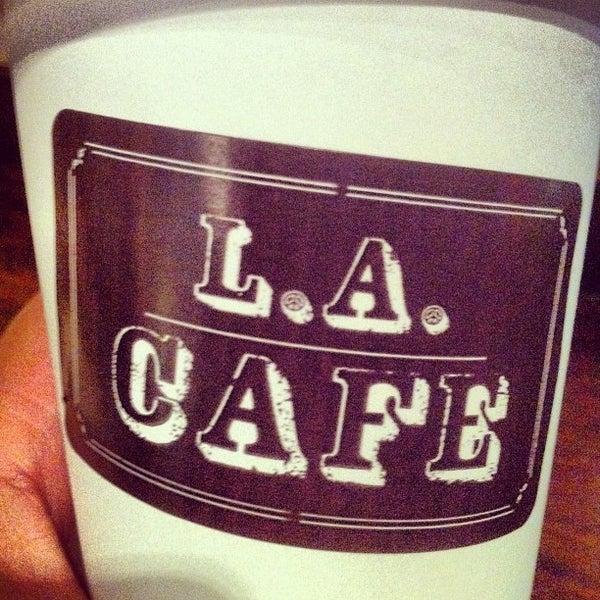 Photo taken at LA Café by Guillermo N. on 7/4/2012