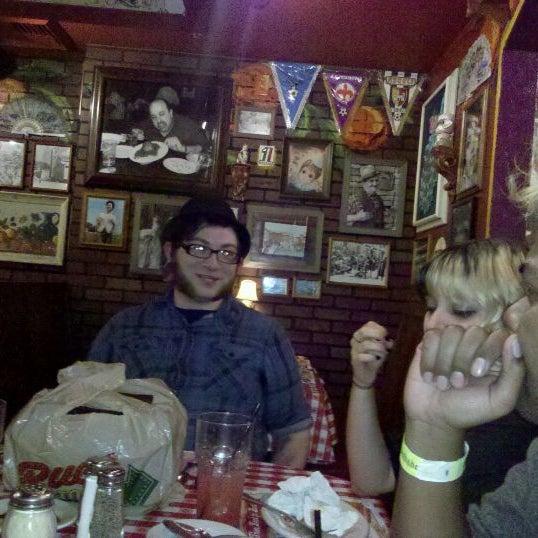 Photo taken at Buca di Beppo Italian Restaurant by Darian C. on 12/12/2011