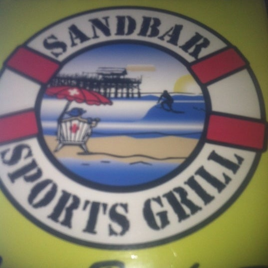 Photo taken at Sandbar Sports Grill by Kylie A. on 4/9/2012