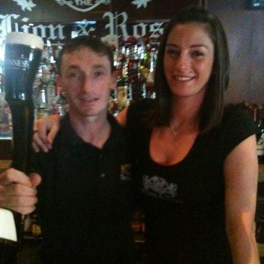 Photo taken at The Lion & Rose British Restaurant & Pub by Katie T. on 5/28/2011
