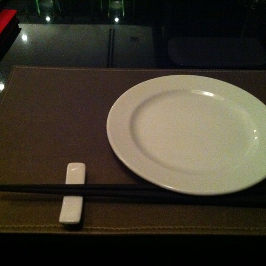 Photo taken at YASASHII Japanese Fusion Cuisine by Ainaveltsac S. on 11/4/2011