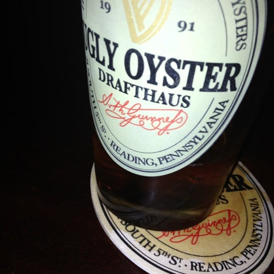 Photo taken at Ugly Oyster Drafthaus by Jake Y. on 7/5/2012
